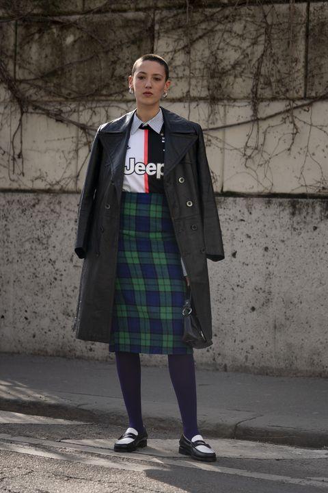 Clothing, Tartan, Kilt, Pattern, Uniform, Street fashion, Design, Standing, Outerwear, Plaid,