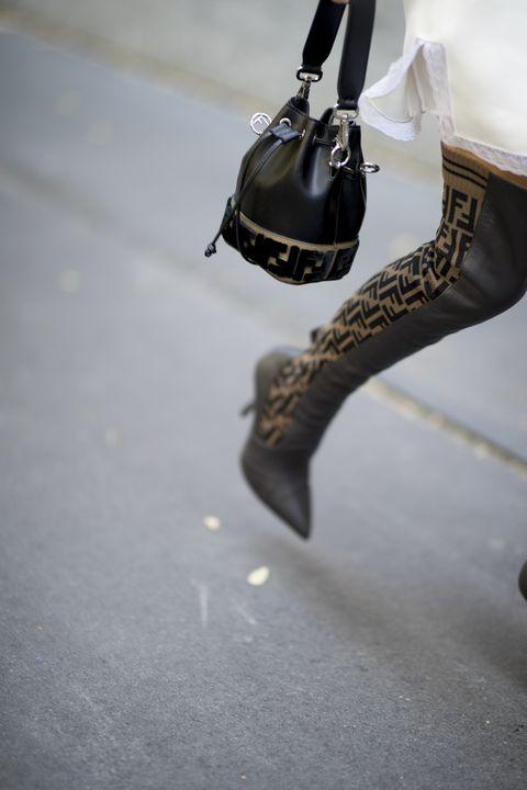 Footwear, Leg, Floor, Ice hockey equipment, Shoe, Ice skate, Ankle, Flooring, Foot, High heels,