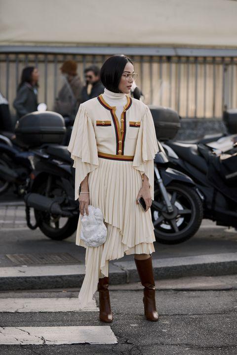 White, Street fashion, Photograph, Clothing, Fashion, Snapshot, Footwear, Shoulder, Beige, Street,