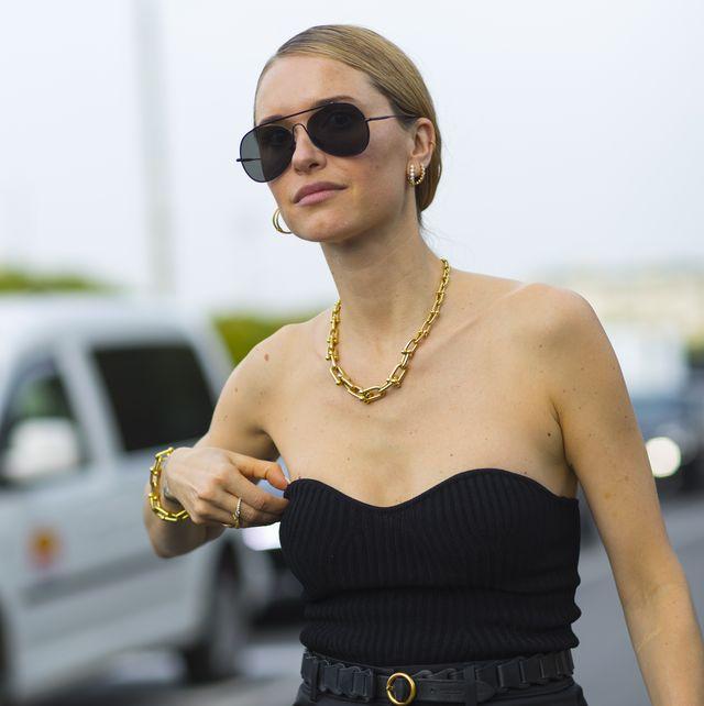 Eyewear, Sunglasses, Clothing, Street fashion, Shoulder, Dress, Fashion, Waist, Little black dress, Yellow,