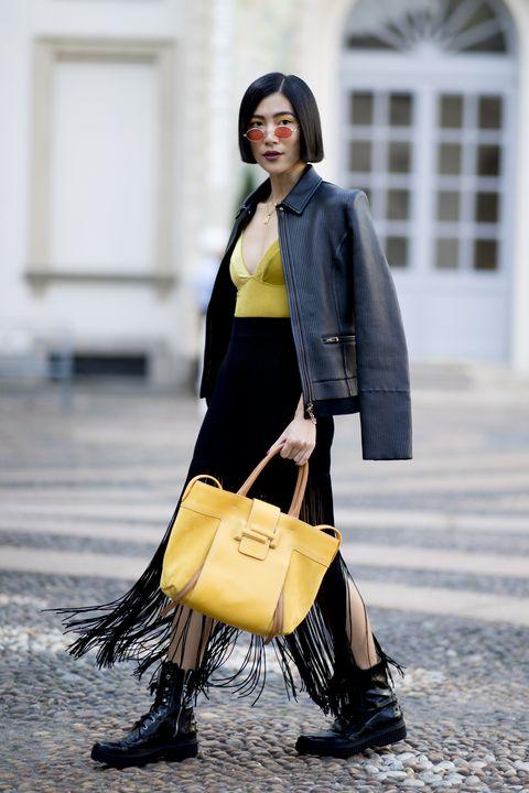 Street fashion, Yellow, Clothing, Fashion, Outerwear, Footwear, Blazer, Leather, Fashion design, Coat,