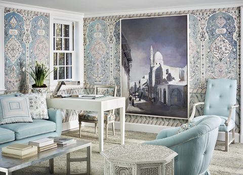 a blue and white room with mosaic tile looking wallpaper and an overscale photo on the wall