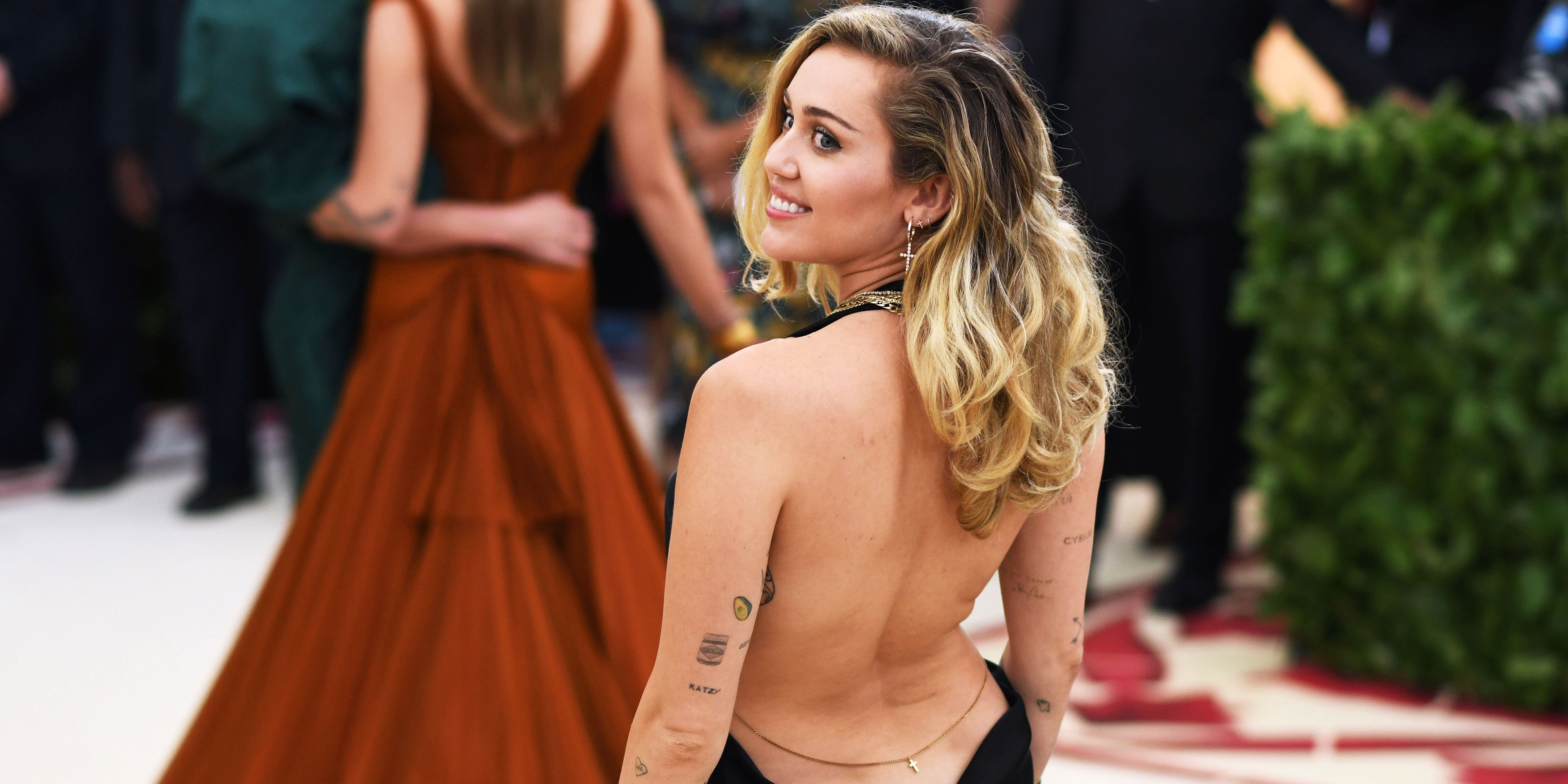 Miley Cyrus' Met Gala Dress Dips So Dangerously Low, There Is No End
