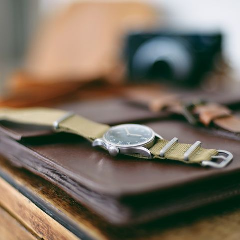 Military wristwatch on wooden cabinet