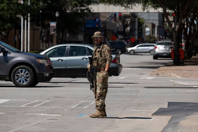 a member of a right wing patriot militia blocks traffic as other members march in downtown louisville, kentucky, on september 5, 2020 photo by jeff dean  afp photo by jeff deanafp via getty images