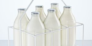 Milk holder with milk bottles