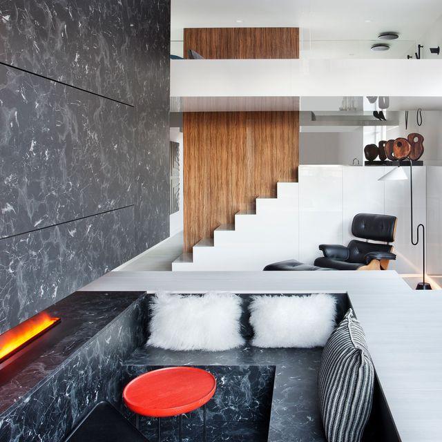 un minipiso de 29m2 aprovechado al máximo salón con chimenea y dormitorio elevado
