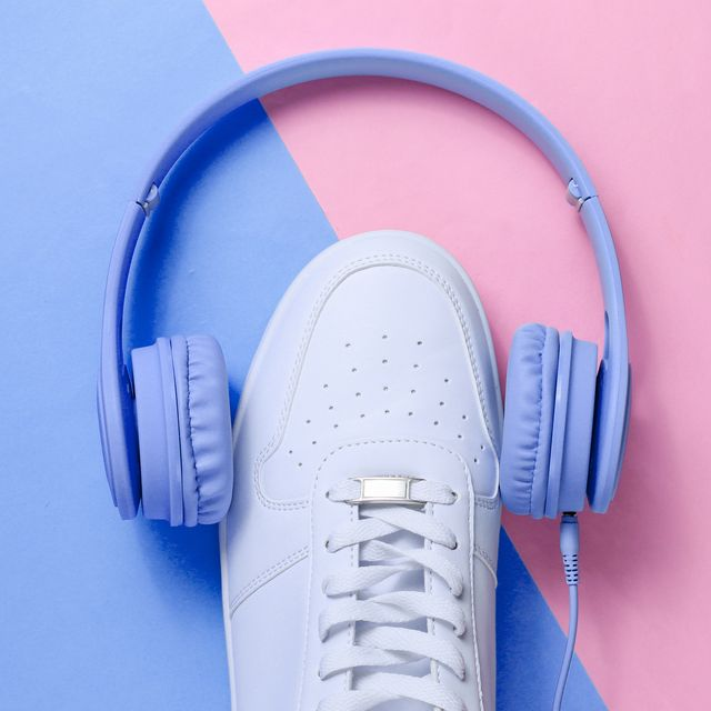 minimalism music lover  headphones, white sneakers on blue pink pastel background top view flat lay