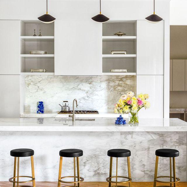 modern white kitchen with marble backsplash