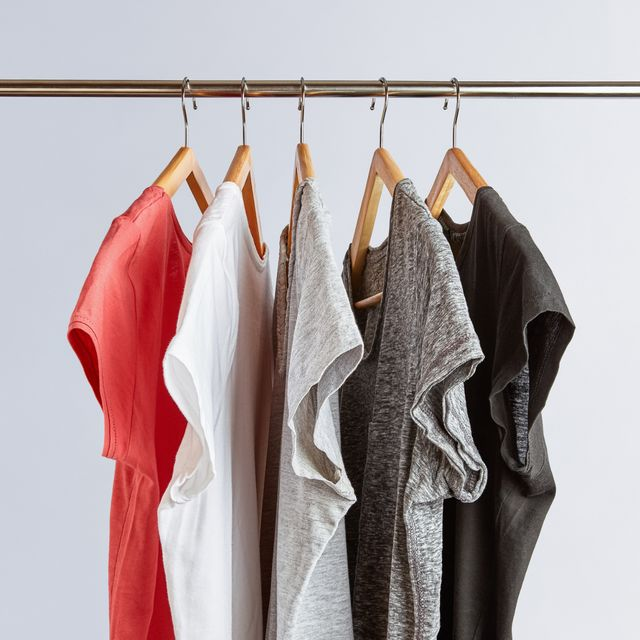 5 short sleeve shirts hanging on a clothing rack