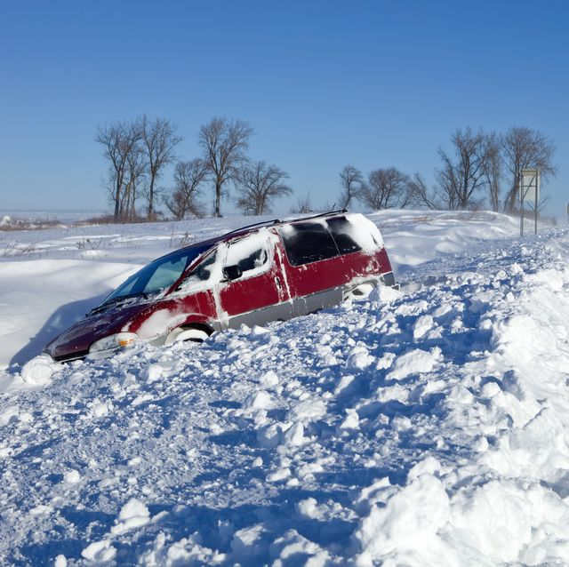 Minivan Stuck in a Snow Filled Ditch along Highway