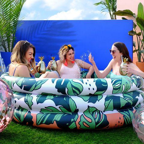 Inflatable, Furniture, Couch, Games, Leisure, Bean bag, Fun, Bean bag chair, Grass, Recreation,