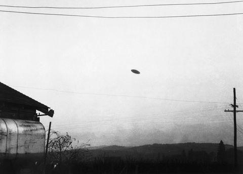 Flying Saucer Flying over Farm