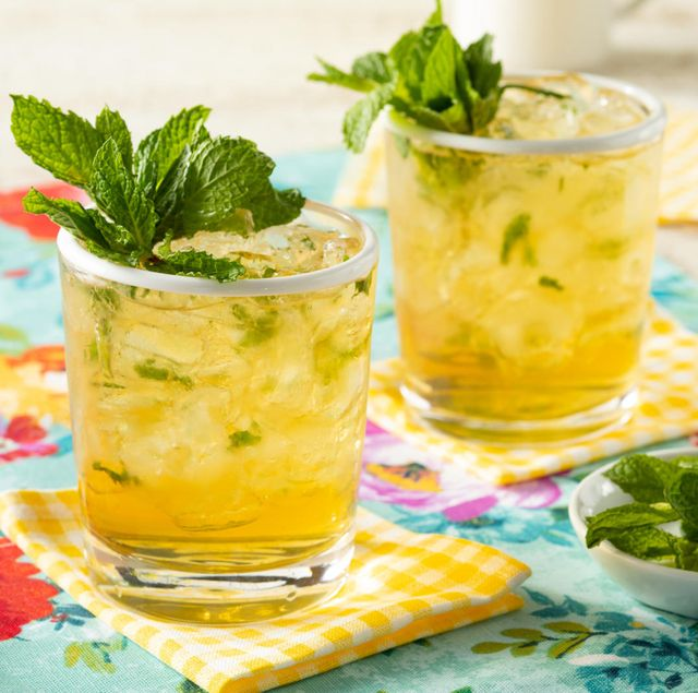 mint julep in two glasses with fresh mint and yellow napkins