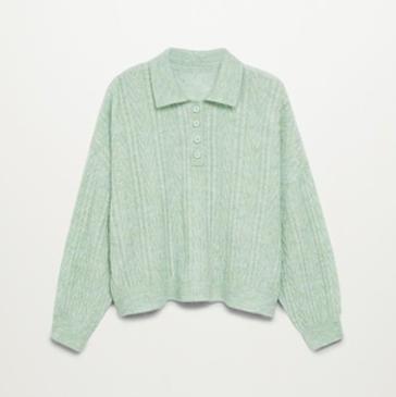mintgroenen trui met knopen