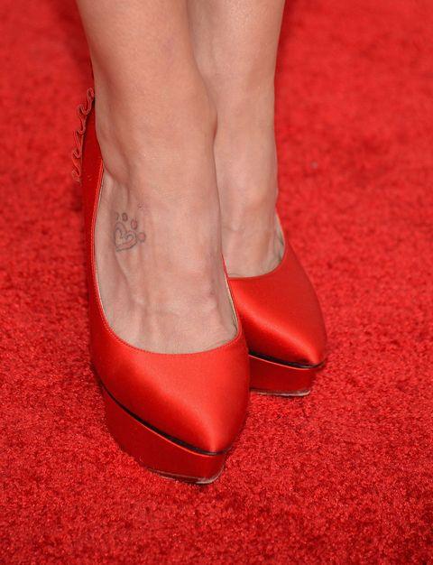 Footwear, Red, High heels, Carpet, Shoe, Leg, Human leg, Red carpet, Ankle, Flooring,