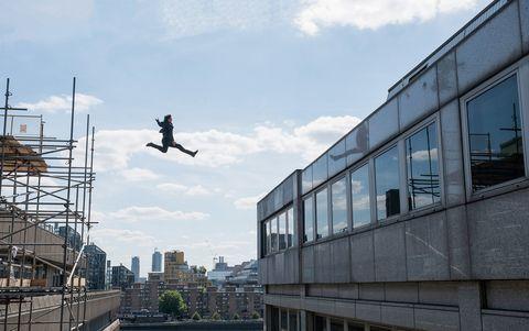 urban area, sky, extreme sport, stunt performer, street stunts, flip acrobatic, architecture, tree, city, recreation,