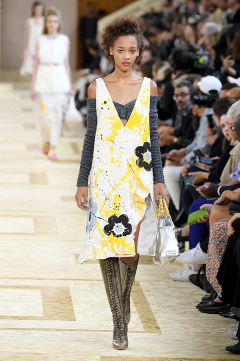 Fashion, Fashion model, Fashion show, Runway, Clothing, Yellow, Fashion design, Shoulder, Event, Dress,