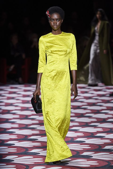 Fashion model, Fashion, Fashion show, Runway, Clothing, Yellow, Fashion design, Dress, Haute couture, Event,