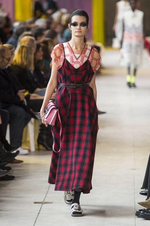 Fashion model, Fashion, Runway, Fashion show, Clothing, Dress, Pattern, Tartan, Fashion design, Design,