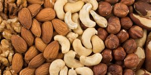 mixe of various nuts background above closeup