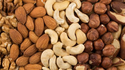 mixe of various nuts background above closeup