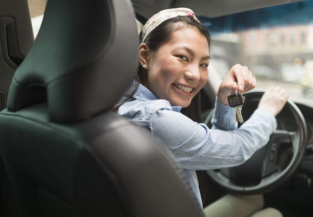 mixed race teenage girl holding keys to car
