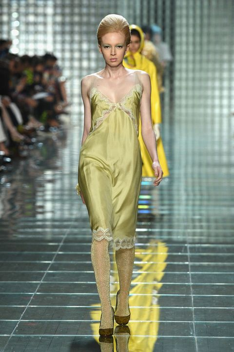 Fashion model, Fashion, Fashion show, Runway, Clothing, Yellow, Shoulder, Haute couture, Dress, Fashion design,
