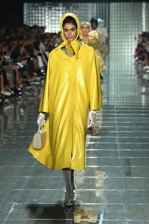 Fashion model, Runway, Fashion, Fashion show, Yellow, Clothing, Outerwear, Shoulder, Footwear, Fashion design,