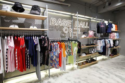 Boutique, Outlet store, Room, Shelf, Closet, Building, Retail, Clothes hanger, Shelving, Furniture,