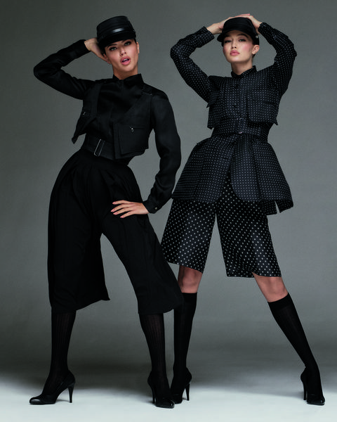 Fashion model, Clothing, Black, Fashion, Dress, Outerwear, Leggings, Shoulder, Footwear, Sleeve,