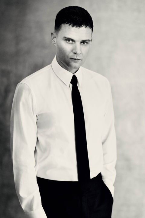 White, Photograph, Suit, Formal wear, Dress shirt, Black-and-white, Standing, Forehead, Monochrome photography, White-collar worker,