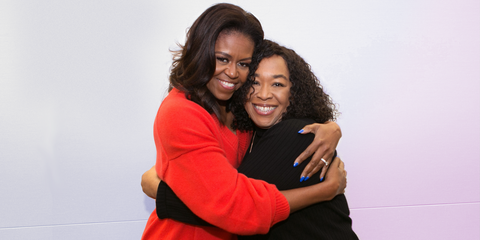 Former First Lady Michelle Obama hugs Shonda Rhimes
