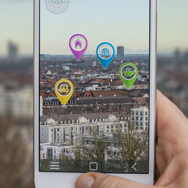 mobile phone displaying city with symbols