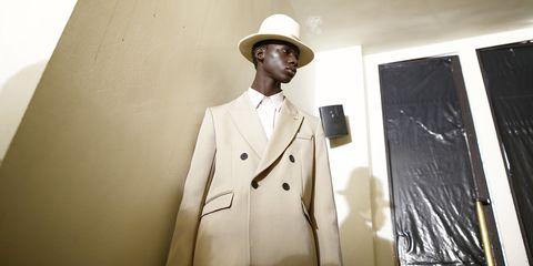 Suit, Clothing, Formal wear, Outerwear, Uniform, Coat, Tuxedo, Fashion design, Headgear, Trench coat,