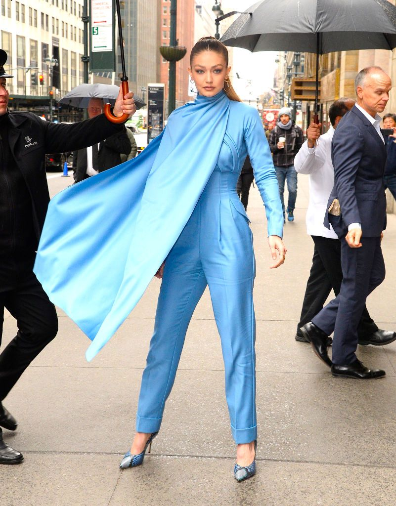 da6ebe7c142 Gigi Hadid Wears Blue Emilia Wickstead Caped Jumpsuit to Variety s Power of  Women in NYC