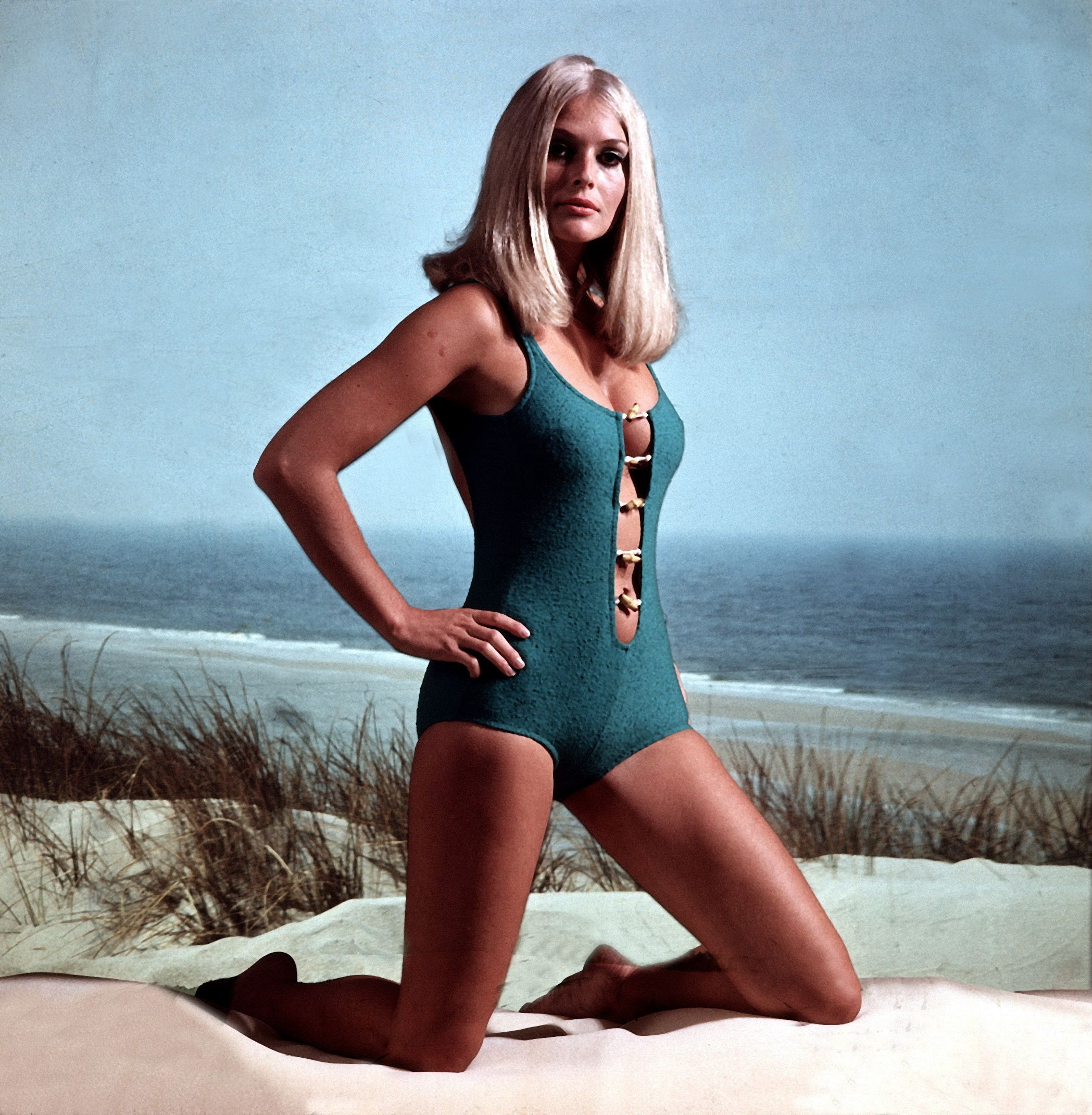 f85aaf2af7 How Swimsuit and Bikini Style Has Changed Through the Years - Most Popular Bathing  Suit the Year You Were Born