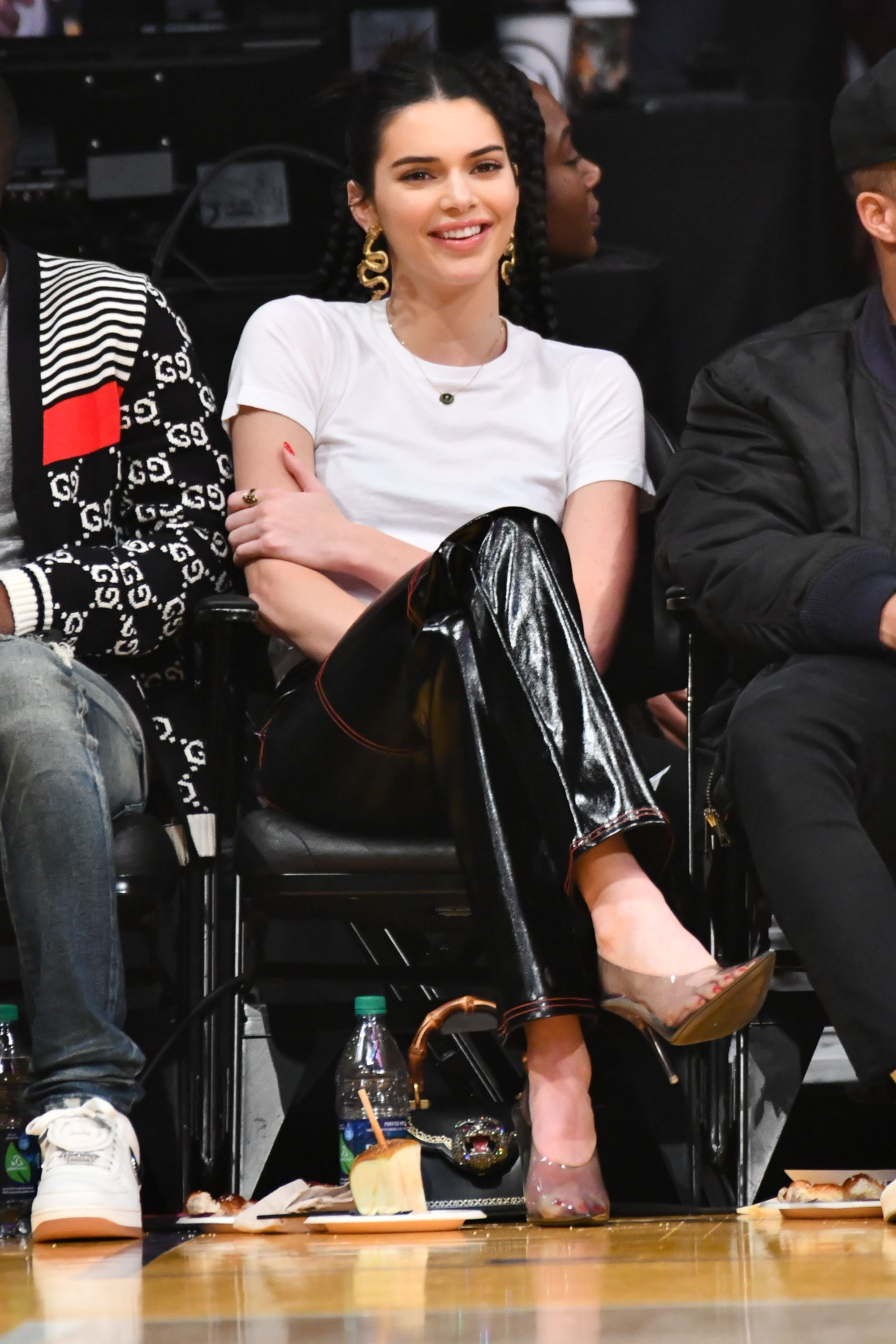 e2508056f83c Kendall Jenner Looks Edgy in Snake Earrings and Leather Pants to Watch Ben  Simmons Play Ball