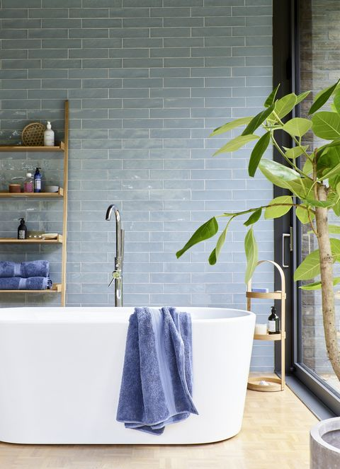 modern bathroom with pale blue tiles
