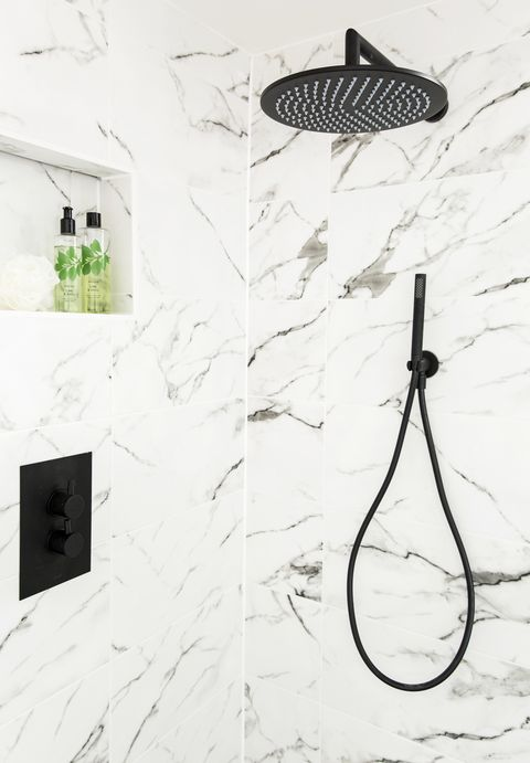 black shower head and fittings on a marble effect tiled wallshowerthe new concealed black shower made use of the existing boxed in pipework for a sleek,streamlined finish