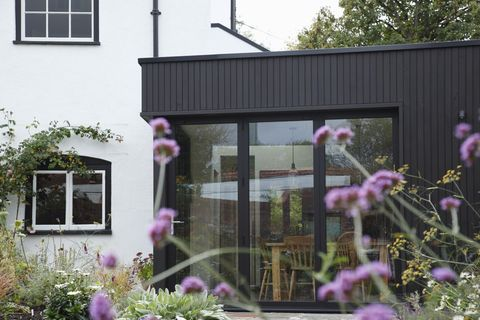 modern extension built onto the side of a listed period property