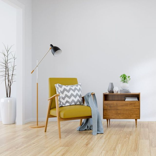 modern mid century and minamalist interior of living room yellow armchair with wood table