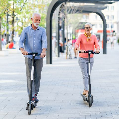 modern senior couple with electric scooter