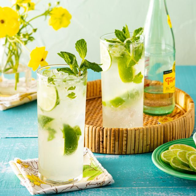 mojito in tall glasses with lime slices and sugar