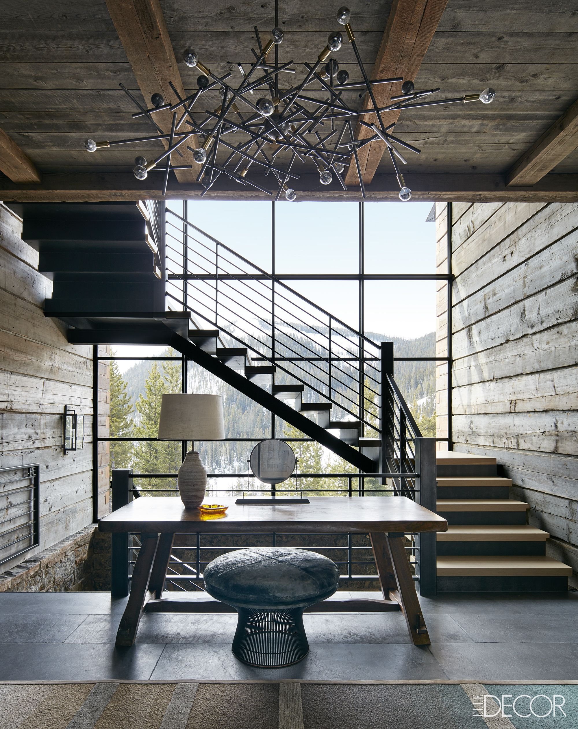 Breathtaking ski chalet entry way with view of mountain and rustic chic decor on Hello Lovely