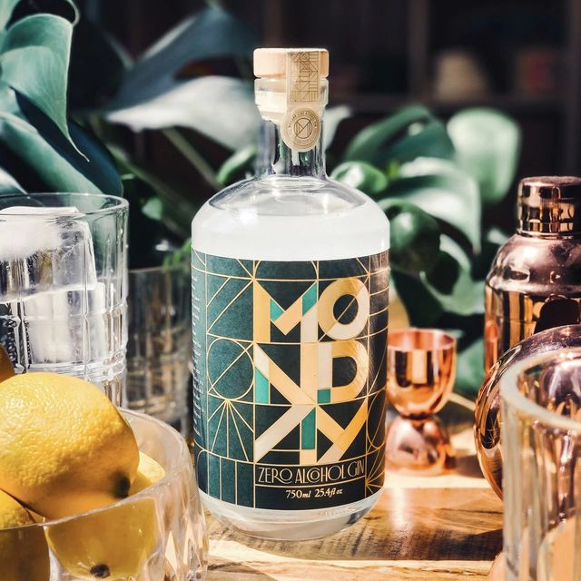 monday gin bottle with bar tools and lemon