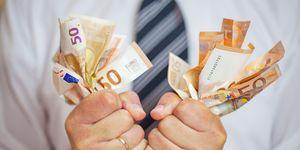Money addicted, Greedy businessman squeezing money. Love of money.