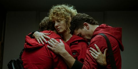 Money Heist: Part 4 still of three characters, including Rio, hugging
