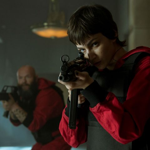 A still from Netflix series Money Heist: Part 4, featuring Úrsula Corberó as Tokyo aiming a gun