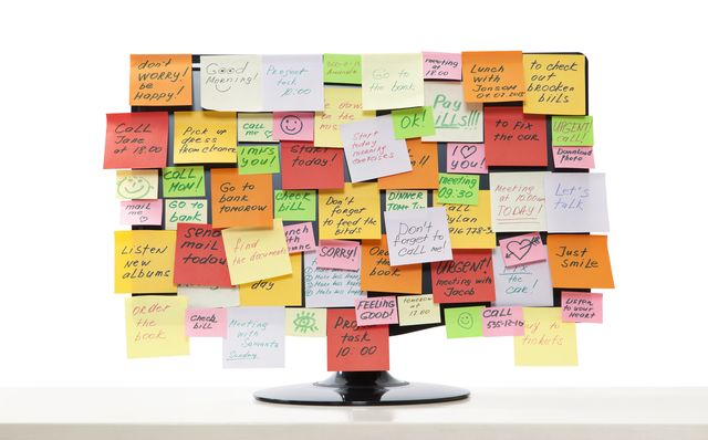 monitor with stickie reminders all over it